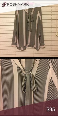 Gorgeous striped silky-like blouse with bow I adore this top!! Worn a couple times but no longer fits me :-(. True size large. Beautiful Black and Tan stripes. Longer in length so can be worn with skinnies. Great for work or going out. Tops Blouses