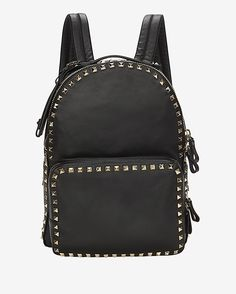 Valentino Rockstud Backpack: Black: A perfectly sized and much welcomed street style backpack with all the luxe and signature rockstud detailing. Two-way top zip closure. Adjustable shoulder straps. Optional luggage tag. Exterior zip pocket. Interior tablet pocket. Measures: 10 W x 13 H x ...