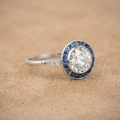 A stunning diamond and sapphire engagement ring. Set with a beautiful old European cut diamond.