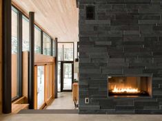 Interior palette: slate fireplace, Douglas fir ceilings, black accents, glass Tagged: Living Room and Two-Sided Fireplace. Eels Lake Cottage by Trevor McIvor Architect. Browse inspirational photos of modern living rooms. Stone Electric Fireplace, Modern Stone Fireplace, Stone Fireplace Designs, Slate Fireplace, Fireplace Ideas, Fireplace Redo, Fireplace Remodel, Contemporary Fireplaces, Fireplace Facing