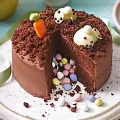 Try the Waitrose Burrowing Bunnies Pinata Cake and impress guests with this charming, chocolatey cake. Avaliable in store (Easter Baking) Easter Lunch, Easter Dinner, Food Cakes, Cupcake Cakes, Easter Recipes, Dessert Recipes, Easter Baking Ideas, Cupcake Recipes, Pinata Cake