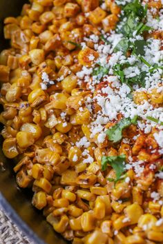 Delicious Mexican Street Corn - a copycat version from Torchy's Tacos that is irresistible and filled with butter, cheese, chili powder and cilantro. Best Mexican Street Corn Recipe, Mexican Street Corn Salad, Mexican Food Recipes, Ethnic Recipes, Mexican Menu, Mexican Night, Mexican Corn, Mexican Dishes, Candy Recipes