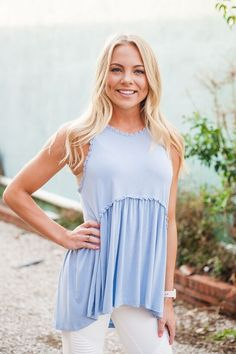 Say hello to springtime with the sky blue pol top. Sleeveless and lovely, this piece plays on texture and detail. With a fitted top that lets out to a more flowy bottom half, this top will keep you comfortable and chic all day long.