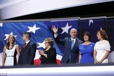 Pence (3rd right) posed and waved with (left to right) daughter Audrey, son Michael, mother Nancy, wife Karen and daughter Charlotte