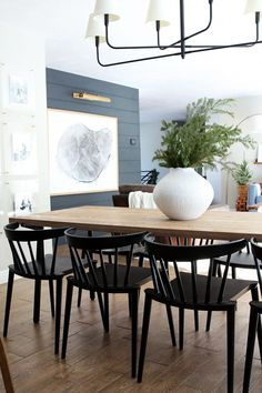 modern black dining room chairs and modern dining room table, large wall art and black shiplap, modern farmhouse dining room design with modern chandelier and neutral dining room decor Home Design, Interior Design, Design Ideas, Design Trends, Modern Interior, Modern Design, Spindle Chair, Swivel Chair, Desk Chair