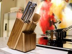 Ten Knife Holders You Can Use To Improve Your Kitchen Storage Magnetic Knife Blocks, Magnetic Knife Holder, Kitchen Knives, Kitchen Gadgets, Cooks Knife, Chef Knife, How To Varnish Wood, Types Of Knives, Glass Blocks
