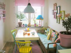 The colors and the pillows and the coziness! Cute little breakfast nook!