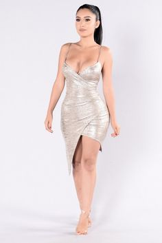 - Available in Gold - Metallic Dress - Knee Length - Spaghetti Straps - Cinched Overlap Design - V Neckline - Made in USA - 96% Polyester 4% Spandex