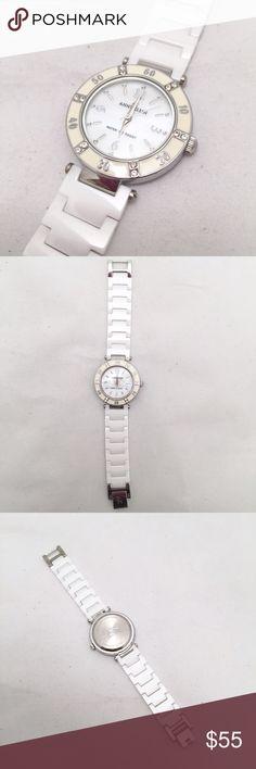 Anne Klein White Ceramic Collection Watch Stunning white ceramic band watch by Anne Klein. Silver accents. 6.5inch length Anne Klein Accessories Watches