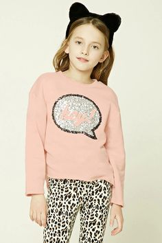 """Forever 21 Girls - A French terry knit sweatshirt featuring a """"Hey!"""" sequined speech bubble graphic, round neckline, long cuffed sleeves, and a raw-cut hem."""