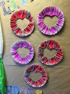 "Making ""Exploding Hearts"" to practice fine motor control and to celebrate Valentine's Day. Students work with the concept of ""Through"" as well during lacing."