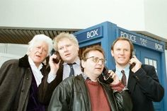 Jon Pertwee, Colin Baker, Sylvester McCoy and Peter Davison in 1993 doing a publicity shot to promote the modern age of mobile phones. Note that those enormous mobile phones were meant to look futuristic next to the old fashioned police box. 