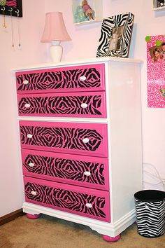 re-purposed dresser for my daughters ZEBRA room. The zebra stencil was purchased at Michael's Crafts.