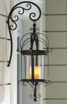 Next to the front door, instead of an electric light. Maybe even have a citronella candle in it?