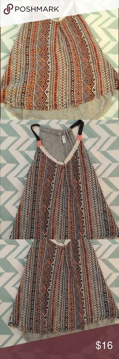 Mixed Media Tank Top The perfect summer wardrobe staple. This mixed media tank top has a drapey fit and a longer back hem for a stylish touch! Tops Tank Tops