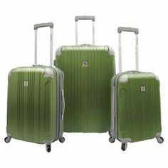 Jetset in style with this textured luggage set, perfect for weekend jaunts and exotic getaways. 3 rolling suitcases feature 360-degree wheels and self-lock telescoping handles.    Product: Small, medium and large suitcaseConstruction Material: ABS composite and aluminumColor: GreenFeatures:  Four-corner riveted protective shells for durabilitySelf-locking telescopic handle system with push-down mechanismFully-lined interior with organizational pockets, tie-down straps and shoes ...