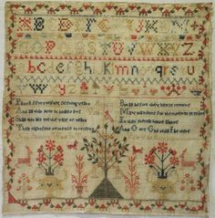 EARLY 19TH CENTURY ALPHABET AND MOTIF SAMPLER BY ANN JACKSON 1822