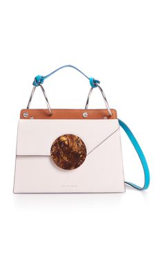 This **Danse Lente** bag is rendered in 100% calf leather and features a circular acetate detail and crossbody strap.