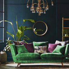 I love everything in this beautiful emerald green and brass living room. Except for the purple accent I love everything in this beautiful emerald green and brass living room. Except for the purple acce Living Room Accents, Living Room Green, Living Room Colors, Home And Living, Living Room Designs, Bedroom Green, Bedroom Colors, Purple Living Room Furniture, Green Painted Furniture