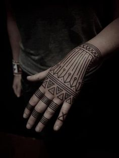 tribal hand tattoo don't like the ring things but the triangles are really cool