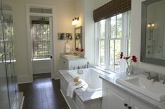 Tub centered between vanities + walnut + marble