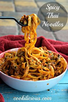 One Pot Spicy Thai Noodles - Cookilicious - Thai cuisine is very distinct. One Pot Spicy Thai Noodles is cooked in red curry paste along with veggies making it an ideal dinner recipe. Bon Appetit!