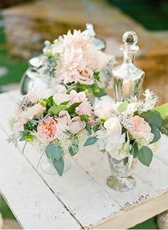 vintage garden wedding centerpieces   Photo by Lane Dittoe
