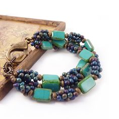 https://www.etsy.com/listing/83513743/turquoise-beaded-bracelet-picasso-glass?ref=shop_home_feat_1