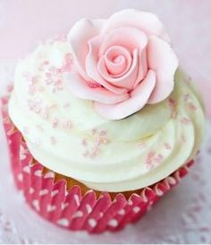 Pink rose cupcake decorated with butter icing - Flickr courtesy of Classikool