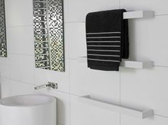 The Kado Quad Wall Mounted Heated Towel Rail in Matte White can have up to 6 rails installed on a single installation kit.