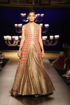 Manish Malhotra at India Couture Week 2014 - red and gold lehnga with long sleeveless cutout jacket