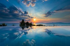 """Inifinty - Sunset shot in the private infinity pool in a resort in Koh Yao Yai.  If you like my work, please follow me on <a href=""""https://www.facebook.com/patrickjendruschphotography"""">FACEBOOK</a> or <a href=""""http://www.instagram.com/patrickjendrusch"""">INSTAGRAM</a> as well!"""