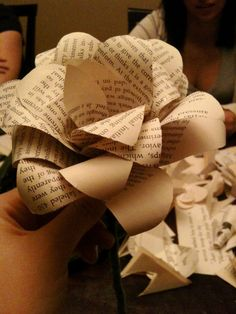 Want to add book-page paper flowers to the centerpieces?