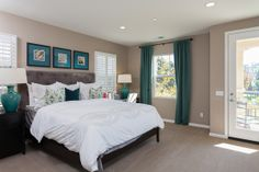 Spacious Master Bedroom with balcony - picture taken from model home.