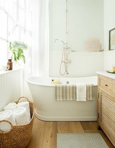 Sweet, sweet, light filled bathroom! Excellent for a Wood or Fire feng shui element areas of your home (east, southeast or south) Love the beautiful floor basket with rolled towels.