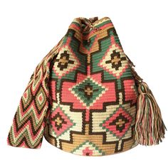 These double thread Wayuu mochila bags are all made in the region of La Guajira, Colombia by indigenous Wayuu women. Mochila bags are a very important handicraft that helps sustain the indigenous Wayuu people. These bags take approximately 10 days to make. The craft of crocheting is learnt at an early age and passed down from generation to generation. The mochilas are a reflection of the everyday shapes that surround the lives of the Wayuu tribe. Buy yours at www.lombiaandco.com Crochet World, Tapestry Crochet, Handicraft, Crochet Projects, Purses And Bags, Pattern, Crafts, Stuff To Buy, Poufs
