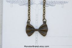 Tiny Bow Tie Necklace Doctor Who Jewelry by MonsterBrand on Etsy, $7.00