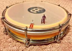 Tamborim brake, little people on a meinl tamborim. By Carlos Adames