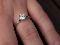Gleaming Solitaire Engagement Rings. This is so simple and I love it.