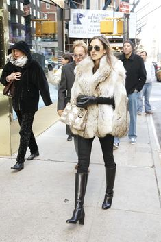 fox cape | New Yorkers are so cute when they think it's cold out, Shoppers outside Bergdorf and Barneys. [Photo by John Aquino]