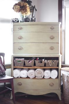 Take an old dresser, paint it up,.remove some drawers for shelf space. Multipurpose dresser!