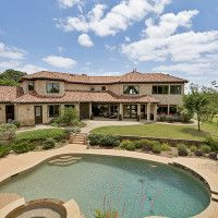 It is almost impossible to find an estate with more than six acres in the heart of Colleyville. This home in a resort-like setting has a large stocked pond. Architect Skip Blake created an elegant home with hardwood and travertine flooring. The kitchen is ideal for entertaining with commercial-grade, stainless-steel appliances, a six-burner gas cooktop and two dishwashers. Outside is a saltwater diving pool and a large cabana.