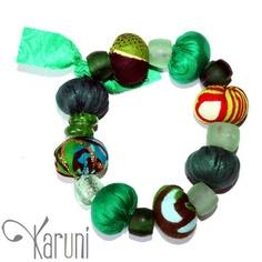 TOUBAB PARIS - Bracelet en tissu africain - Miniboules perlé - dominante verte