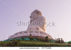 Side view of Phuket Big Buddha Statue at Phuket, Thailand while surrounding area under construction - stock photo