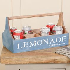 A wonderful addition for any style home, this blue wooden crate can be used for a variety of uses! Perfect for carrying drinks through the summer months, this crate can also be used to display herbs and small plants or other decorative accessories! With eight individual sections, the crate has a strong wooden handle for easy carrying and extra decoration. Finished with wording 'Lemonade a grand mixer' this decorative storage crate is a fabulous item for your home.