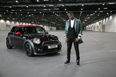 """Labrinth poses with the MINI Hatch featured in his hit video """"Earthquake,"""" featuring Tinie Tempah."""