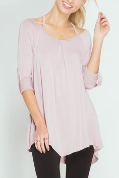 Rolled up long sleeve tunic with cross back strap. Flowy fit. Model is wearing a small.  Crisscross Rollup Top by She  Sky. Clothing - Tops - Long Sleeve Iowa