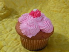 Strawberry Cream....A moist strawberry cake infused with extra vanilla, filled with marshmallow cream with chopped strawberries and piped with strawberry flavored frosting and a dainty little flower.