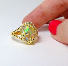Large opal, aquamarine, white diamond and 14k yellow gold ring. #opalsaustralia