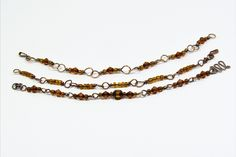 CopperJEWEL set of three bracelets with copper wire and glass beads.